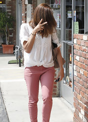 Eva Mendes wore this gauzy white button down with a pair of colorful pink pants.
