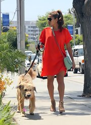 Eva loves bright shift day dresses like this citrus number she wore to walk her pup.