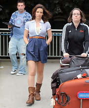 Evangeline Lilly arrived at the airport in casually girly attire. The 'Lost' star teamed her shirtdress with a pair of slouchy flat leather boots.