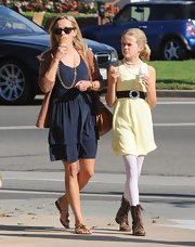 With her pearls and classy yellow dress, Ava clearly has her mother's sense of style.