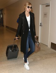 Gigi Hadid made her way through LAX pulling a gray rollerboard.