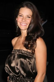 """Evangeline Lilly showed off off her long brunette curls while attending the """"Elixie On Main Street"""" premiere in New York."""