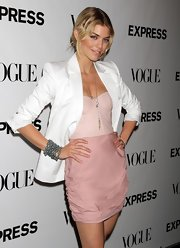 Annalynne paired her blush pink ensemble with a loose, messy bun.