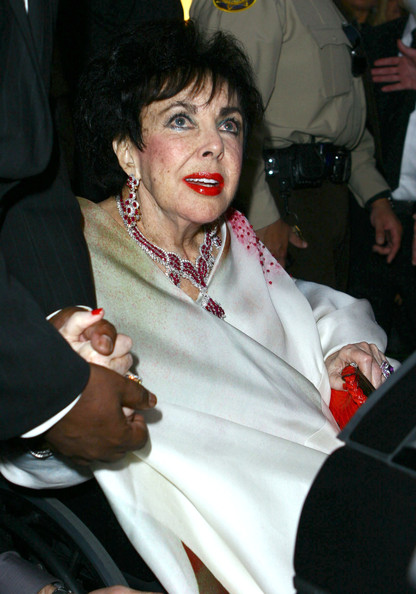 Elizabeth Taylor looked red carpet-ready with her ruby and diamond chandelier earrings and matching necklace.