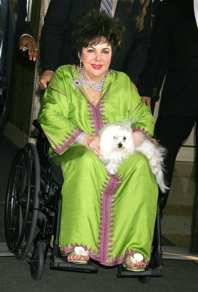 Elizabeth Taylor was as enchanting as ever in her green and purple caftan.