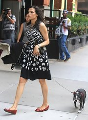 Famke Janssen stepped out in a black-and-white animal print frock.