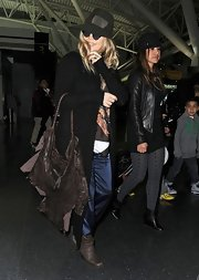 Fergie's hobo bag gave a new meaning to distressed with its shredded, ripped look.