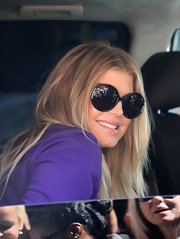 Fergie greeted her fans from her car while sporting these big circular frames.