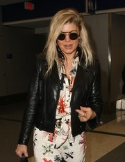 Fergie accessorized with a pair of modern round shades by Thom Browne for a flight to LAX.