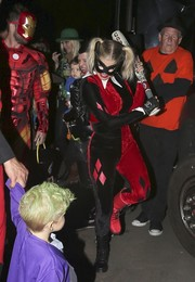 Fergie went trick-or-treating dressed up as Harley Quinn in a red and black velvet catsuit.