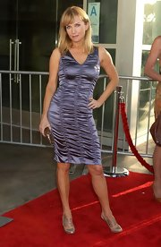 Rebecca wore a ruched satin dress with elastic-strapped, metallic pumps.