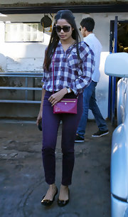 Freida Pinto played with purple in an adorable plaid shirt and matching skinny jeans.