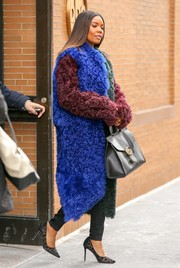 Gabrielle Union was impossible to miss in her Dion Lee color-block shearling coat while out and about in New York City.