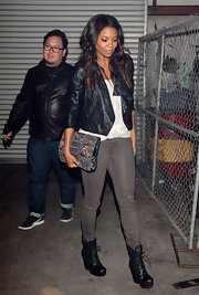 Gabrielle Union toughened her urban street style with an open front leather jacket and leather coated pants.