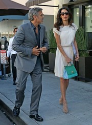 Amal Clooney paired her dress with strappy nude peep-toe heels.