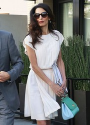 Amal Clooney hid her eyes behind a pair of oval sunnies while out on a lunch date in Beverly Hills.