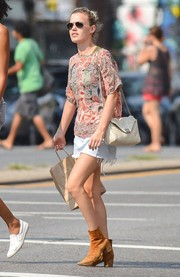 Georgia May Jagger teamed her blouse with a frayed denim mini skirt.
