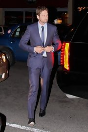 Gerard Butler stepped out in a bright and modern, notch lapel purple suit while out in Washington DC.