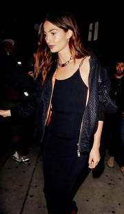 Lily Aldridge toughened up a black knit dress with a net bomber jacket by Alexander Wang for Gigi Hadid's birthday party.