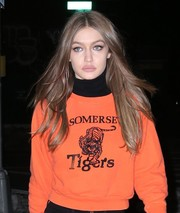Gigi Hadid wore her long hair loose in a chic center-parted style for a day out in New York City.
