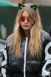 Gigi Hadid was spotted out in New York City wearing a green cat-ear headband by Flower Children Only.