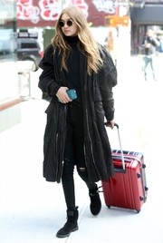 Gigi Hadid completed her all-black look with a pair of flat suede boots by Giuseppe Zanotti.