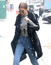 Gigi Hadid was seen out in New York City rocking a distressed silver sweater by Zoe Jordan.