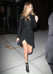 Gigi Hadid matched her top with an asymmetrical, layered mini skirt, also by Brandon Maxwell.