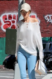 Gigi Hadid kept a low profile with a pair of round shades and a leather cap while out and about in New York City.