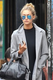 Gigi Hadid looked uber cool in her blue Ray-Ban aviators while out and about in New York City.