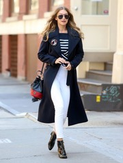 Gigi Hadid showed off a crisp navy trenchcoat while doing a photo shoot in New York City.