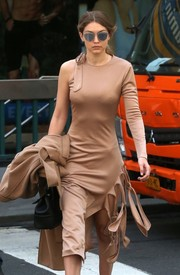 Gigi Hadid cut an ultra-modern figure in a one-sleeve, knot-detail nude dress by Jonathan Simkhai while out and about in New York City.