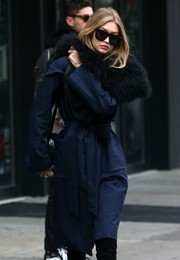 Gigi Hadid headed out in New York City wearing a pair of oversized square shades by Karen Walker.