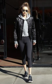 Gigi Hadid completed her outfit with black capri leggings by Reebok.
