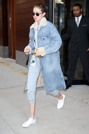 Gigi Hadid covered up in a denim coat by Fear of God for a day out in New York City.