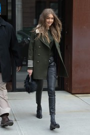 Gigi Hadid headed out in New York City looking sharp in a Tommy Hilfiger military coat with a fur collar and striped cuffs.