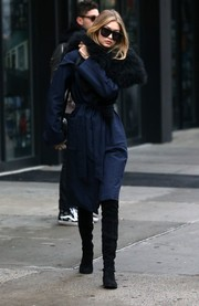 Gigi Hadid cut a glamorous figure in a fur-accented navy coat by Kempner while out and about in New York City.
