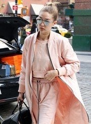 Gigi Hadid looked futuristic in her silver Dior So Real sunglasses while out and about in New York City.