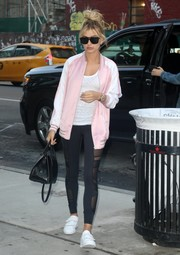Hailey Baldwin teamed her jacket with on-trend sheer-panel leggings.