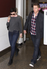 Ginnifer Goodwin added a pair of casual black lace up boots to her cozy look.