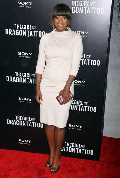 Viola Davis added shine to her sophisticated white cocktail dress with a rosy clutch and bronze peep-toes.