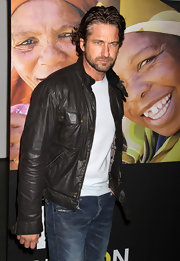 Gerard Butler looked showed off his casually cool side in classic jeans and a brown leather jacket.