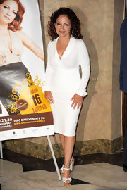 Gloria Estefan wore a form-fitting white day dress to an event in Milan.