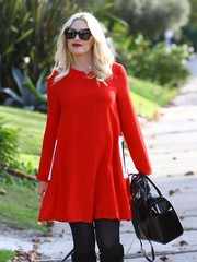Gwen Stefani looked flawlessly styled during Thanksgiving with her butterfly sunnies and bright red dress.