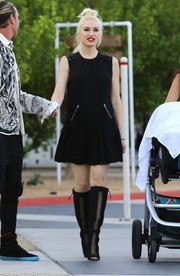 Gwen Stefani added a rocker edge to her look with a pair of knee-high, mesh-panel peep-toe boots.