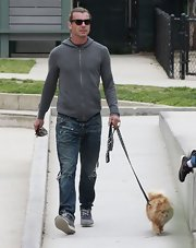 Gavin Rossdale kept it low key with this gray zip-up hoodie while out at the park with this family and adorable dog.