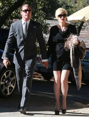 Gwen Stefani went for classic elegance in a black cowl-neck dress when she attended a wedding in Simi Valley.