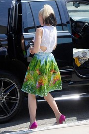 Gwen Stefani looked funky, as always, in a white tank top with a slashed back while headed to church.