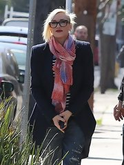 Gwen Stefani brightened up her look with a multi-colored checkered scarf while out with husband Gavin Rossdale.