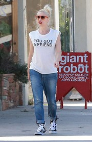Gwen Stefani teamed her tee and jeans combo with a pair of Jeremy Scott x Adidas sneakers that featured jagged accents at the back.